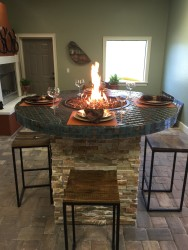 Bar height fire table, with real stone veneer. Glass tile  top surrounding flaming fire glass!